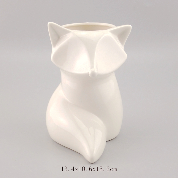 white ceramic fox pen holder